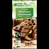 Bio Vollmilchschokolade mit ganzen Nüssen (22%)