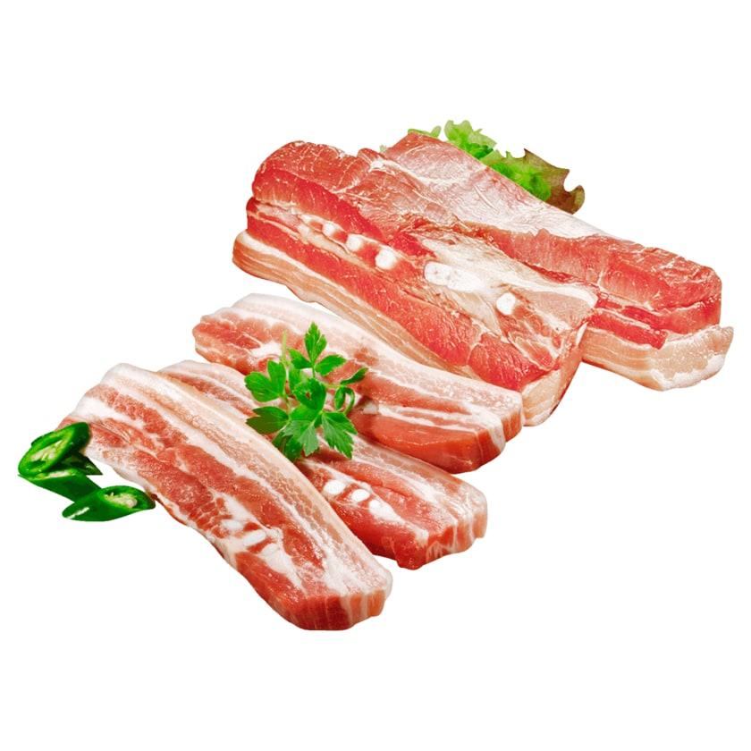 Schweinebauch mit Knochen in Scheiben